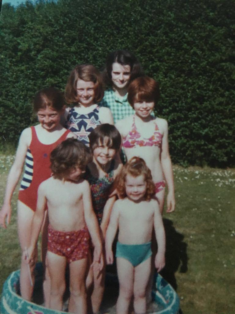 Some of my brothers and sisters & two of my cousins in the garden in our swimming pool!